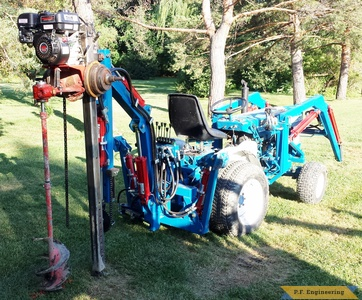 Ford 1210 Micro Hoe with post hole attachment by Charlie H., Fraser, MI