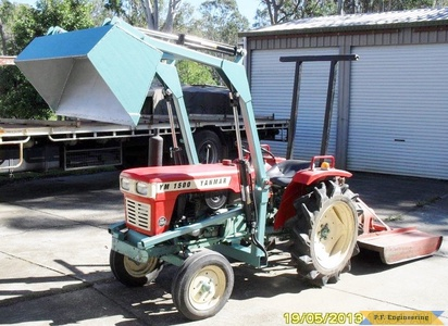 yanmar 1500 compact tractor loader raised bucket dumping