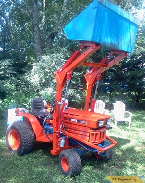Kubota B5200 compact tractor loader raised bucket