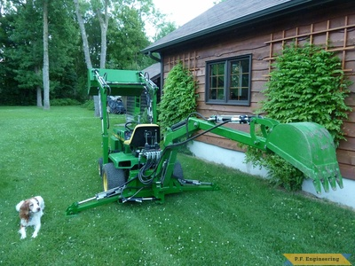 John Deere 318 Micro Hoe Loader with the project supervisor by Walter K., Pointe Claire, Quebec, CN