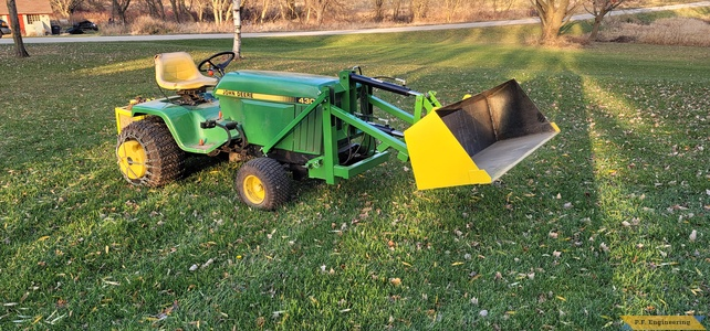 Alan B. from Neosho, WI JD430 mini payloader - all painted up